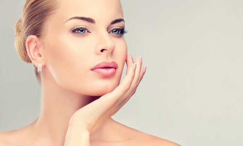 Beautiful Young Woman with Clean Fresh Skin close up . Skin care